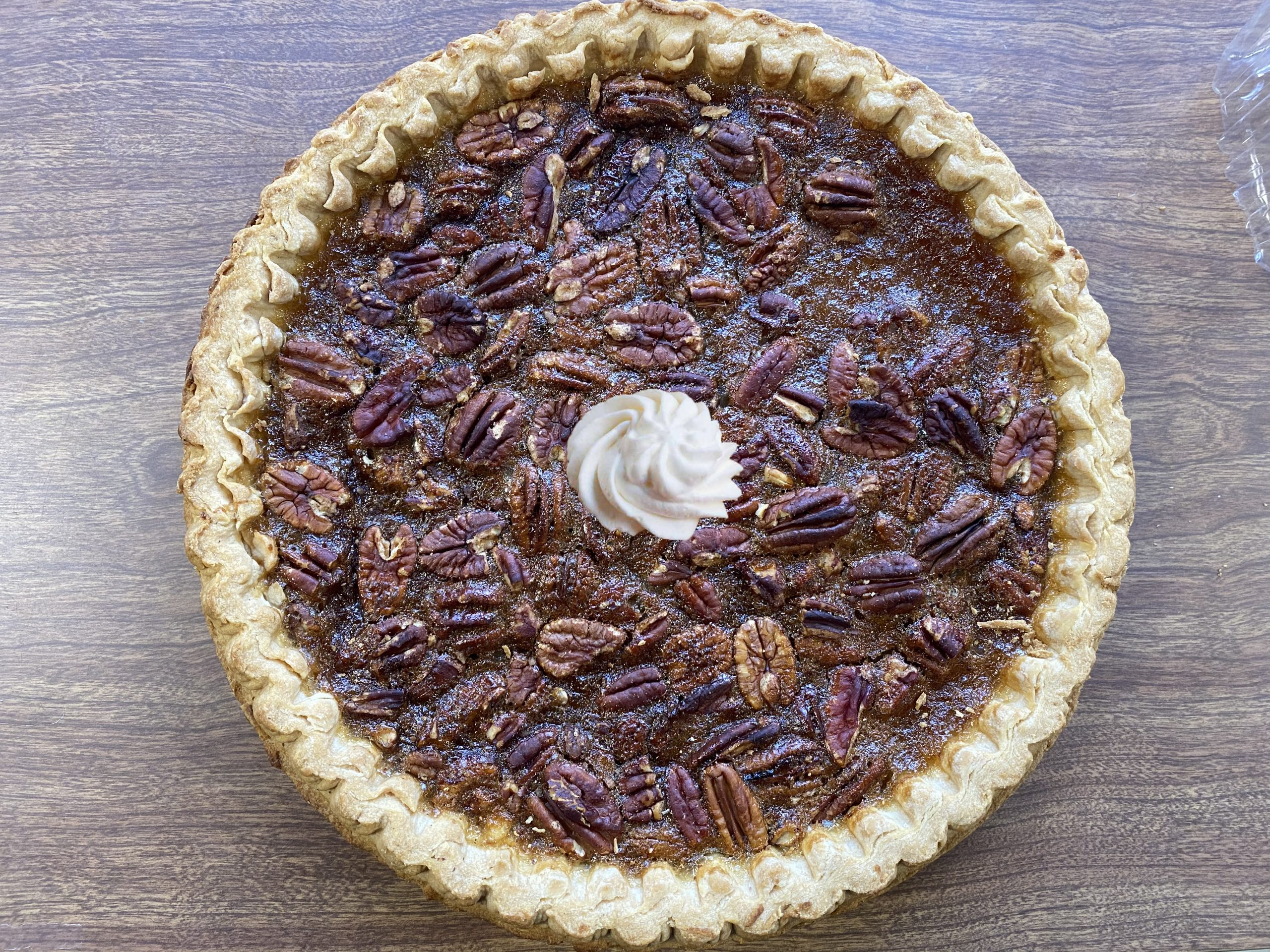 Pecan pie with whipped cream in the middle