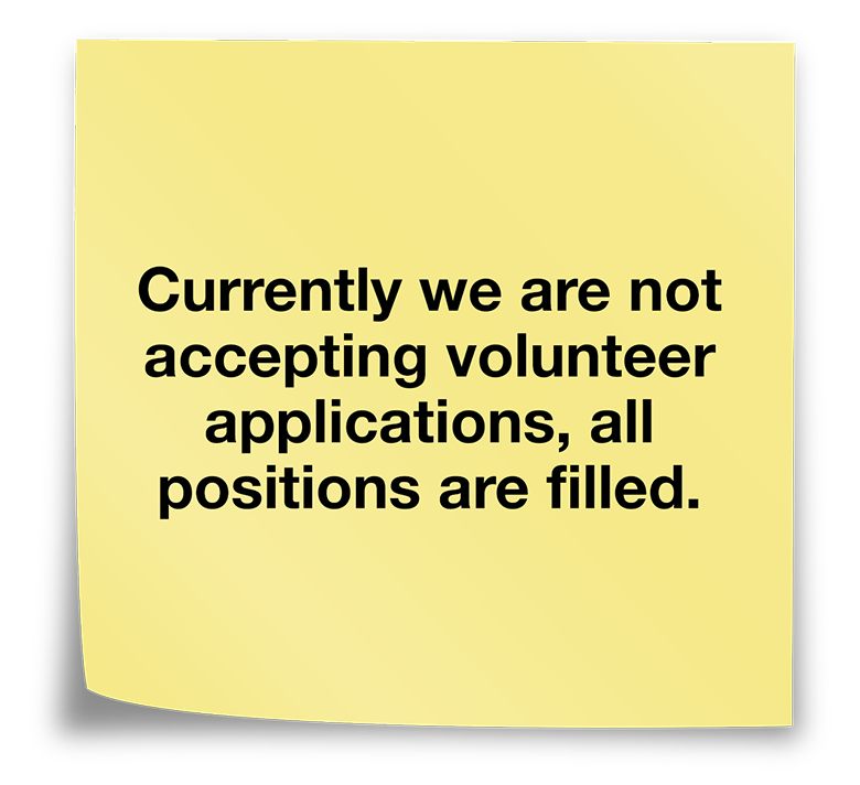 Post it note that says currently we are not accepting volunteer applications, all positions are filled